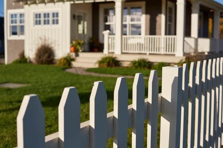 White picket fence in the front yard