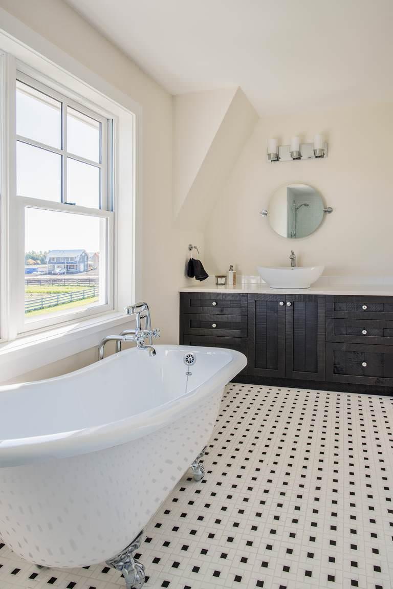 Claw tub in master bathroom with views of the farm thru the window